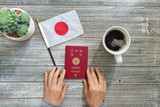 Japanese passport on a wooden desk from above - 215582867