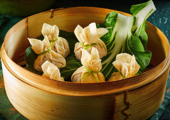 Dim sum dumplings in bamboo basket © exclusive-design