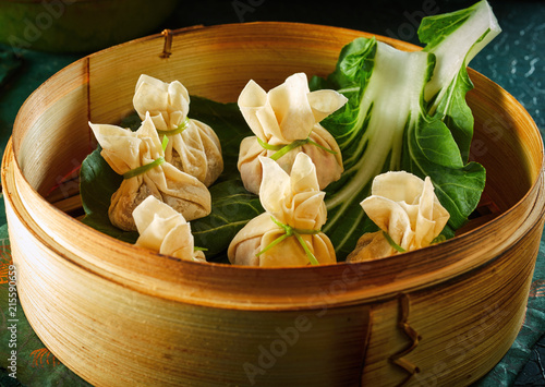 Dim sum dumplings in bamboo basket