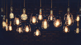 Beautiful vintage luxury light bulb hanging decor glowing in dark. Retro filter effect style. - 215604896