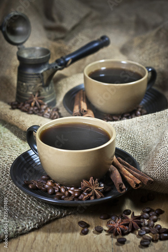 Two cups of coffee with spices - 215611485