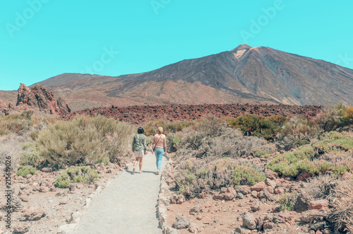 Foto Spatwand Turkoois Tourists walking in The National Park of Las Canadas del Teide, Canary Islands , Spain. Beautiful unearthly landscape background of Volcano El Teide.