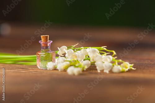 Foto Spatwand Lelietjes van dalen Essence of flowers on table in beautiful glass jar