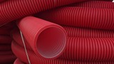 Warehouse of finished plastic pipes industrial outdoors storage site. Manufacture of plastic water pipes factory. Process of making plastic tubes on the machine tool with the use of water and air - 215629858