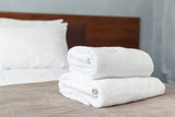 White towel on bed in guest room for hotel customer - 215631477