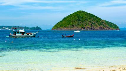 Beautiful view from Banana Beach of Coral (Koh He) Island, Phuket, Thailand. Aspect ratio 16:9.