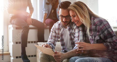 Wall mural Happy couple surfing on tablet at home