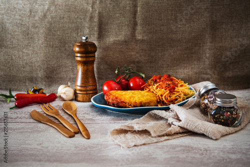 Escalope of spaghetti with tomatoes sauce and basil - 215657631