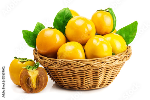 Foto Murales persimmon in basket on white background