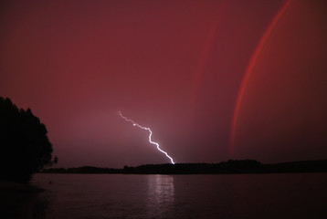 rainbow and lightning at the same time © Dmitriy