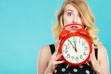 Shocked girl with alarm clock on blue. - 215700009