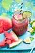 Leinwandbild Motiv Fresh watermelon smoothie with lime in jug