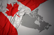 waving colorful national flag and map of canada.