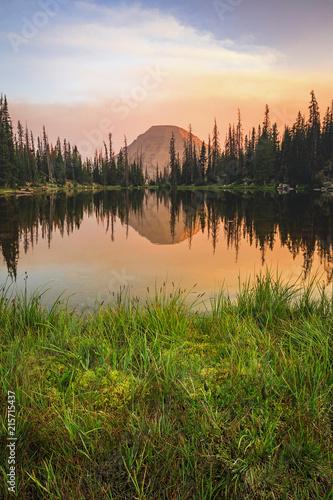 Foto Spatwand Zalm Smoky sunset reflection in the Uinta Mountains, Utah, USA.