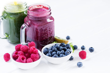 Smoothie vegetables and berry bottles
