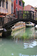 Venice - narrow canal and bridge - famous place, Veneto, Italy.