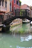 Venice - narrow canal and bridge - famous place, Veneto, Italy.