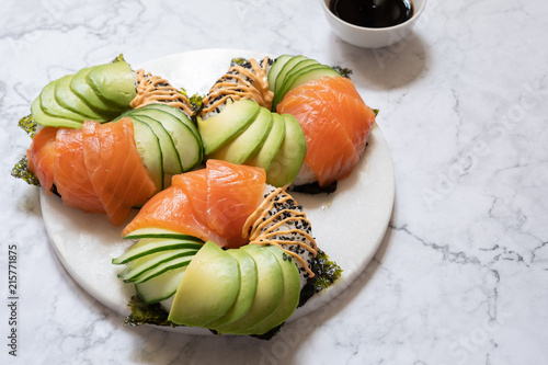 Canvas Sushi bar Sushi donuts with salmon avocado and cucumber