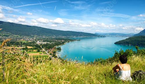 Plexiglas Pool woman looking at Annecy lake in France