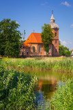 Beautiful brick church in country side near Morag, Poland - 215778273