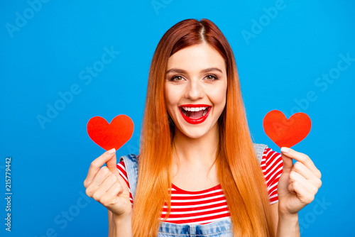 Leinwandbild Motiv People person fun joy funny facial expression concept. Close up phoyo portrait of charming glad gorgeous nice cute lovely lady showing holding small little hearts in hands isolated background