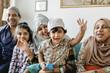 Leinwandbild Motiv Muslim family relaxing and playing at home
