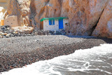 Greece, the famous Black Beach of Santorini with the little Fisherman House, greek Cyclades Islands - 215793819