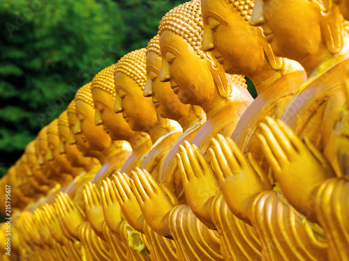 Fotobehang Boeddha Rows of Buddha statues in temple, Thailand.