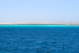 Mahmya island at Red Sea in Egypt, idyllic beach of Mahmya island with some boats in turquoise water, Egypt - 215803648