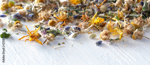 Leinwandbild Motiv Header or banner for homeopathy/natural pharmacy: mix from dried herbs and blooms on white wooden ground