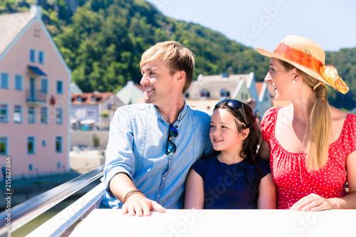 Fototapeta Happy family on river cruise in summer sitting in ship