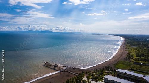 Foto Spatwand Blauwe hemel Beautiful aerial view of Costa Ricas Beach with a beautiful Pier
