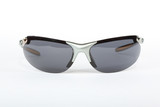 Old sport sunglasses with silver plastic frame and a gray glass on a white background