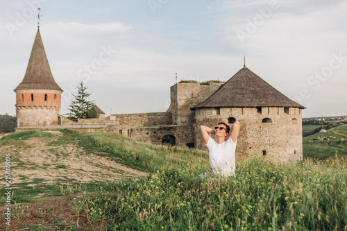 Foto Murales tourist girl fortress ruins journey history building