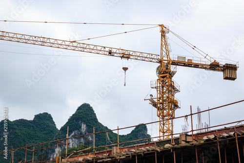 Fotobehang Guilin Tower crane on a background karst peak
