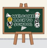 Welcome Back to school text on black board  - 215903466