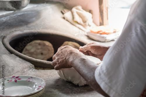Chapati, Tandoori naan or roti - indian. Baked dough in earthen jar.