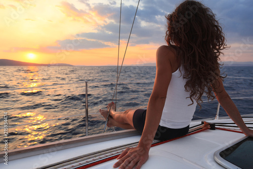 Attractive woman enjoys sailing and sunset, Mediterranean sea, Croatia