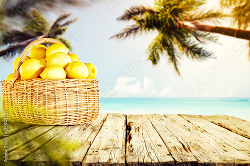 Wooden desk of lemns fruits and palms background, Free space for your decoration.