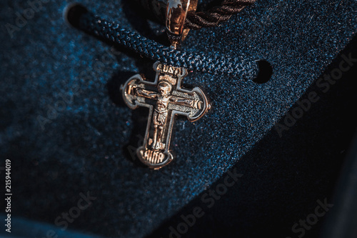 Gold cross in blue box, for baptism. Macro
