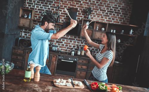 Romantic couple on kitchen - 215953246