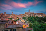 Siena. Cityscape aerial image of medieval city of Siena, Italy during sunset.