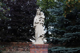 The statue of the Virgin Mary with the crown holding the baby Jesus in her arms in the Sanctuary of the Mother of God, in the Swieta Katarzyna, Lower Silesian Voivodeship - 215961874