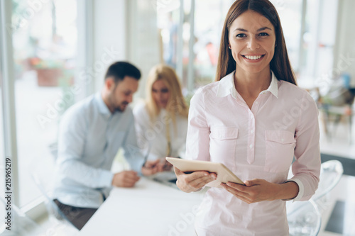 Leinwanddruck Bild Portrait of successful businesswoman holding digital tablet