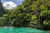 Clear water of Palawan Lagoon. Coron Philippines. Tropical island lagoon - 215973037