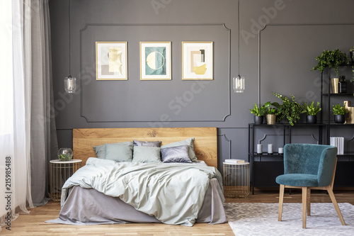 Double bed with grey bedding and wooden headboard standing in dark on wainscoting dining room, wainscoting in attic room, wainscoting window, wainscoting coat rack, wainscoting living room, wainscoting door, wainscoting frame, wainscoting plans, wainscoting shelf,