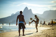 Quadro Unrecognizable young Brazilians play a game of beach football keepy-uppy