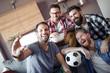 Quadro Happy male friends take selfie