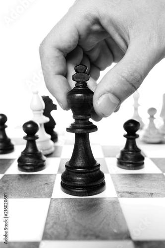 Leinwandbild Motiv Businessman Hand Holding a Chess Piece