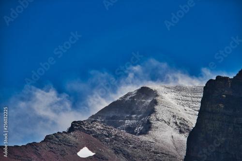 Foto Murales Snow Blowing off a Peak